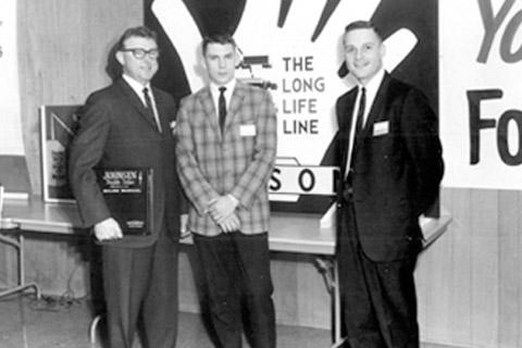 Dealers convention: Richard Johnsen Sr., Richard Johnsen Jr., Trade show representative.