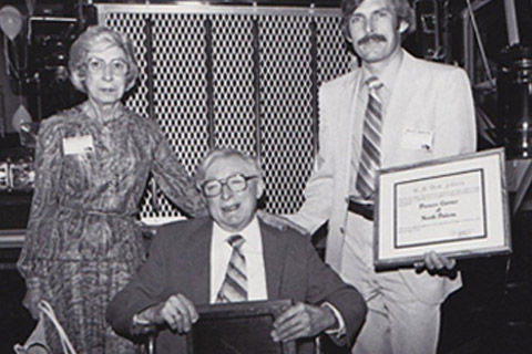 Johnsen Family 'Dad,' Richard Johnsen Jr (right) wins an award, accompanied by his parents, Niva and Richard Johnsen Sr.